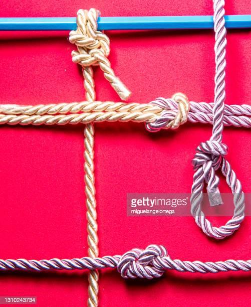 sailor knot with silk ropes - miguelangelortega fotografías e imágenes de stock