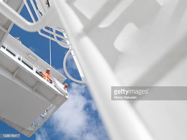Sailor looking over ship's bridge