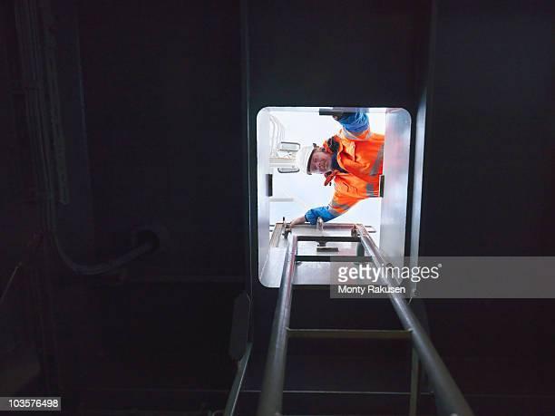 Sailor looking through hatch
