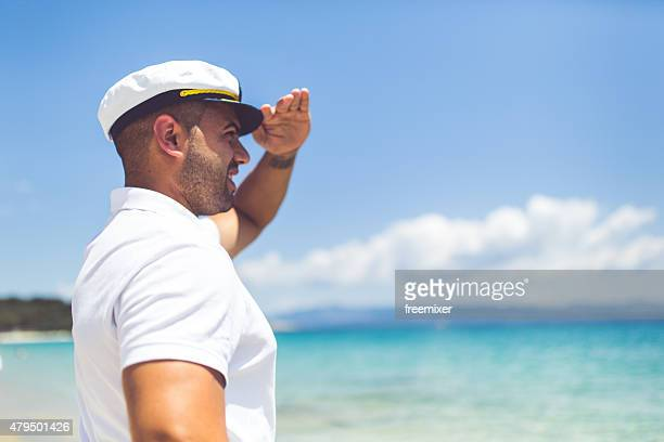 sailor man at the beach - sailor hat stock pictures, royalty-free photos & images
