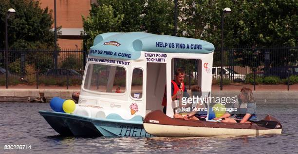 Sailor Martin Berkeley serves up ices from a Ben Jerry's ice cream van on the River Thames in Millwall south London Martin plans to float 140 miles...