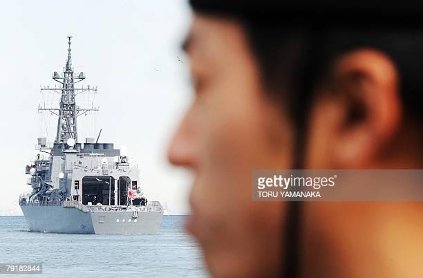 Sailor of Japan's Maritime Self Defense Force sees off its destroyer Murasame when it departs Yokosuka Naval Base, suburban Tokyo, 24 January 2008....