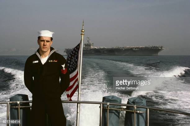 sailor on american aircraft carrier - aircraft carrier stock pictures, royalty-free photos & images