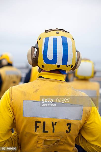 sailor on flight deck of the uss carl vinson - jake warga stock pictures, royalty-free photos & images