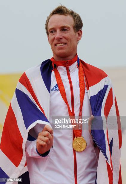 Sailor Paul Goodison of Great Britain celebrates his gold medal in the Laser Radial class at the 2008 Beijing Olympic Games on August 19, 2008 in...