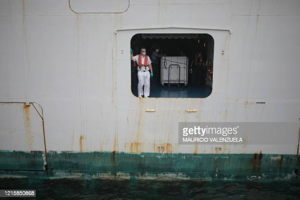 "Sailor performs a docking maneuvre aboard of the ""Caribbean Princess"" cruise as it arrives to the port of Colon, in Panama, on May 28, 2020. - About..."
