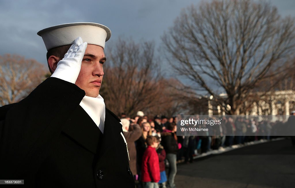 A sailor salutes during a funeral service at Arlington National Cemetery for two unknown sailors who were killed in 1862 when the Civil War era USS Monitor sank off the coast of North Carolina March 8, 2013 in Arlington, Virgiina. The sailors' remains, recovered when a portion of the ship was raised eleven years ago, were buried with full military honors.