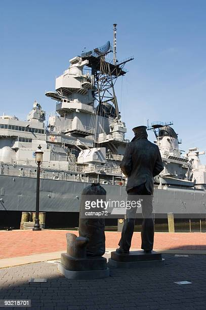 sailor standing with us navy battleship, ww2 uss wisconsin - norfolk virginia stock photos and pictures