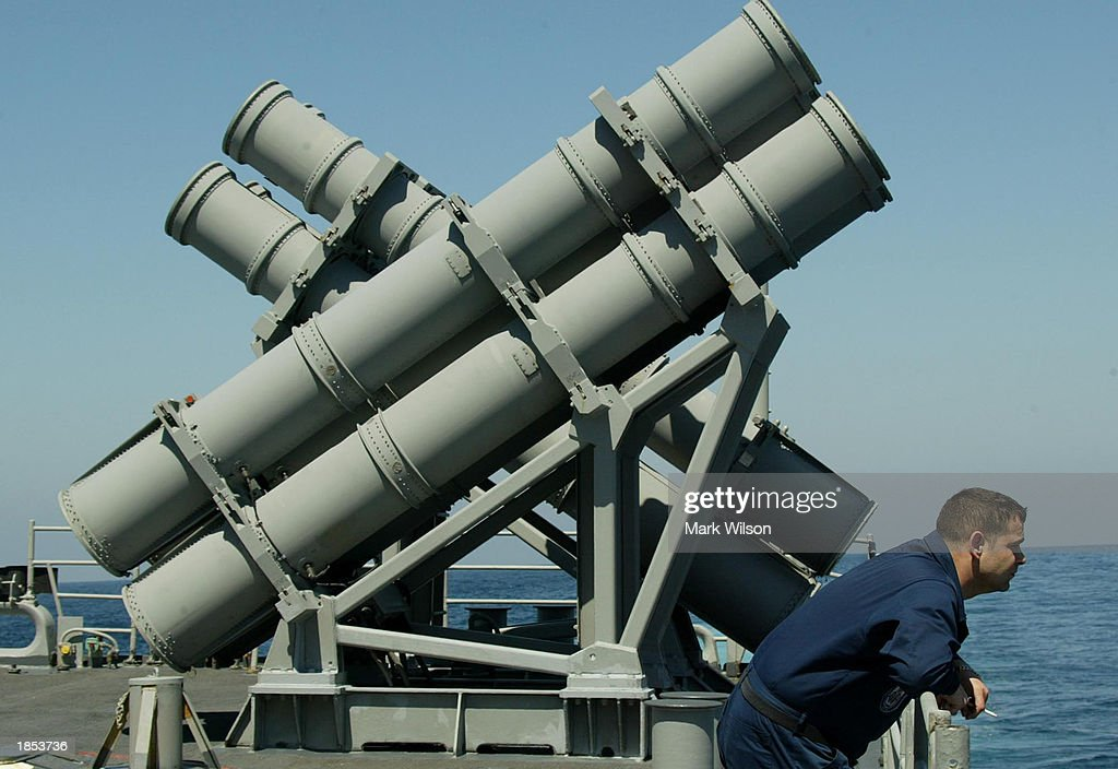 sailor-stands-next-to-a-harpoon-mark-7-missile-launcher-aboard-the-picture-id1853736