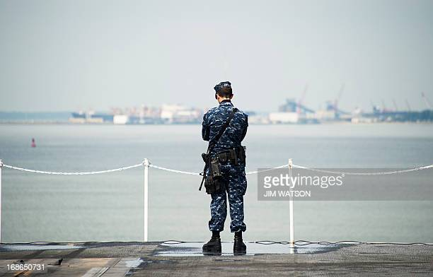 A sailor stands security watch aboard USS Harry S Truman at Naval Station Norfolk in Norfolk Virginia May 8 during the Department of Defense's tour...