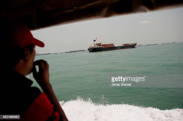 A sailor takes a cigarette break during his session on a freighter ship that is anchored in the Strait of Malacca 585 people were taken hostage six...