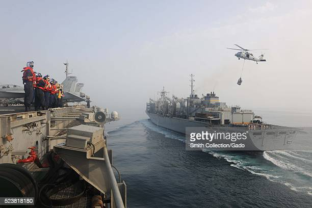 Sailors aboard the aircraft carrier USS Theodore Roosevelt CVN 71 prepare to conduct an underway replenishment with the Military Sealift Command fast...