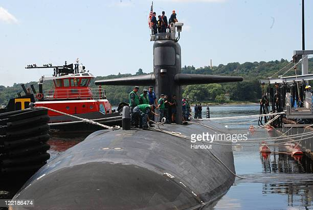 Sailors aboard the Los Angelesclass attack submarine USS Providence cast off lines August 26 2011 in Groton Connecticut The submarine was preparing...