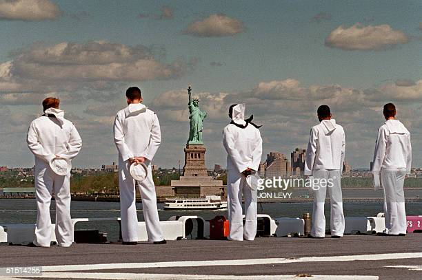 Sailors aboard the USS Wasp man the rails as the multi purpose amphibious assault ship reaches the Statue of Liberty 21 May 1997 during openning...