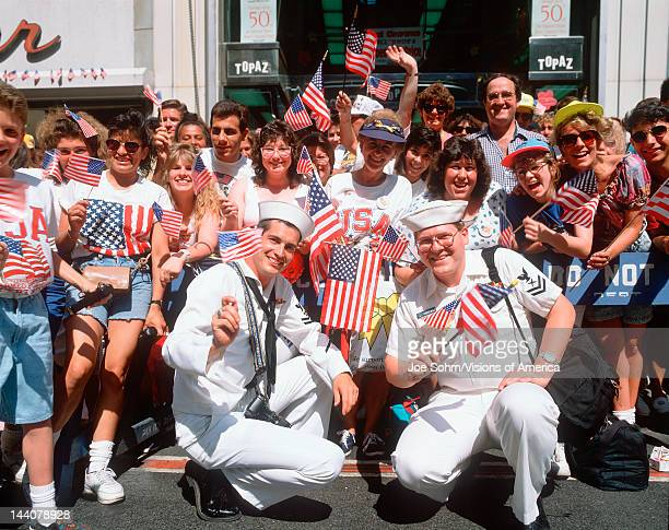 Sailors and crowd waving American flags at Desert Storm Victory parade in New York City New York