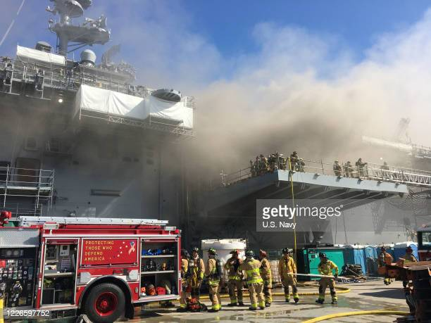 Sailors and Federal Fire San Diego firefighters combat a fire aboard the amphibious assault ship USS Bonhomme Richard July 12 2020 On the morning of...