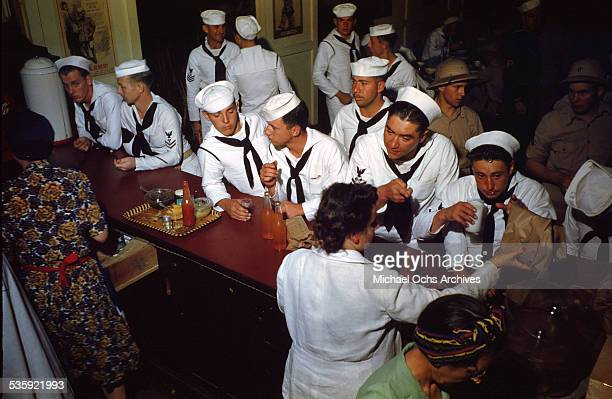 S Sailors and Marines from the USS Iowa drink on shore leave at United Serves Club in Bermuda