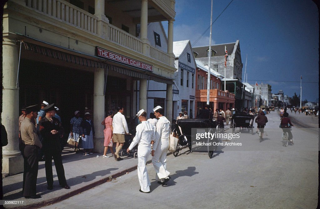 U.S. Sailors and Marines from the USS Iowa on shore leave at the Bermuda Cigar Store in Bermuda.