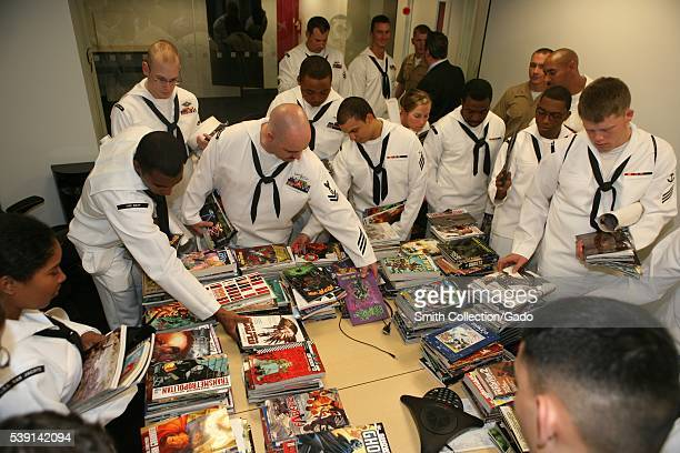 Sailors and Marines look through comic books during a tour of the DC Comics facility during Fleet Week New York 2012 Image courtesy Mass...