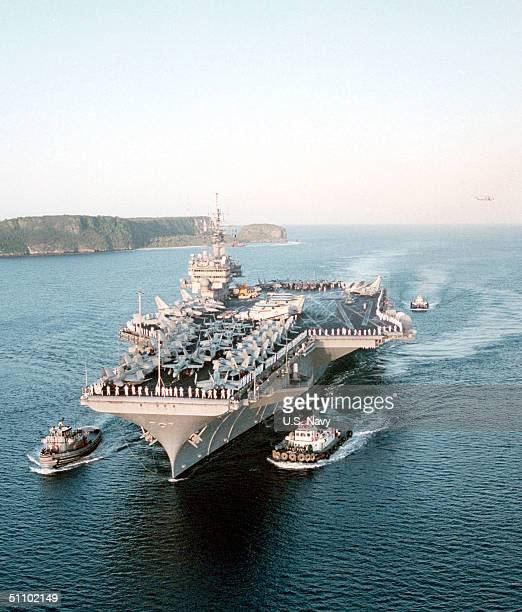 """Sailors And Marines """"Man-The-Rail"""" On Board USS Kitty Hawk While Entering Apra Harbor, Guam April 3, 1999 Following The Multi-National Exercises..."""
