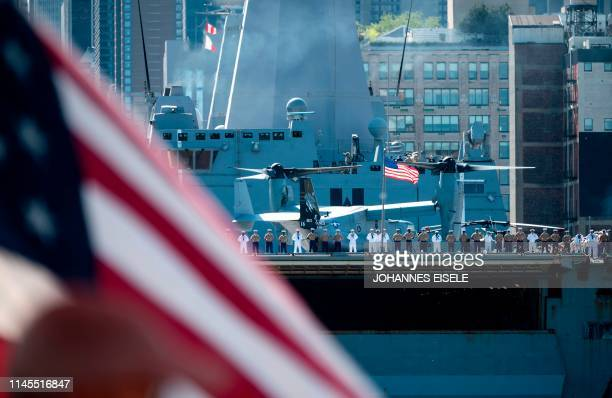 Sailors and Marines stand on the deck of the USS New York as the US Navy vessel takes part in Fleet Week 2019 on May 22 in New York