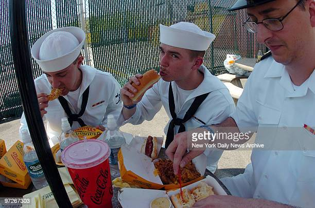 Sailors at Nathans in Coney Island AOAN Joseph Bruner LTJG Kevin Ross and AT3 Brian Yancey Their first time in NY