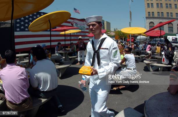 Sailors at Nathans in Coney Island first time in NY AOAN Joseph Bruner gets hot dogs