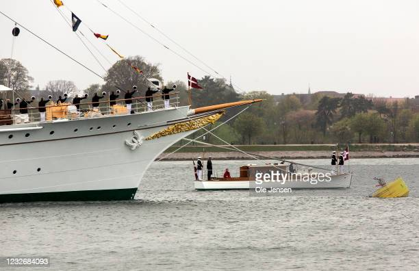 Sailors at the Royal ship, Dannebrog, salute the Queen as she passes by, during the official embarkment to the Royal ship on May 4, 2021 in...