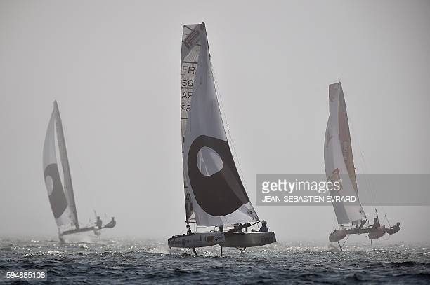 Sailors compete in a regatta aboard their flying phantom series a new generation of foiling catamarans on August 24 2016 in La Baule western France /...