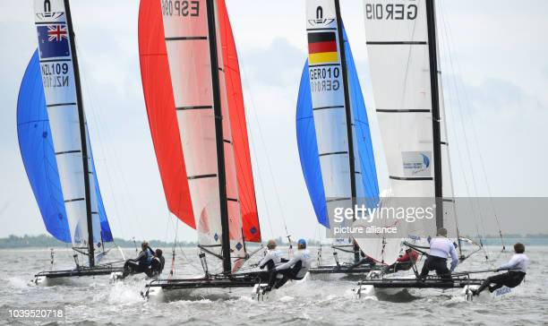 Sailors compete in a sailing race of the new Olympic Nacra 17 class on the Baltic Sea off KielSchilksee Germany 24 June 2013 4500 athletes from 50...