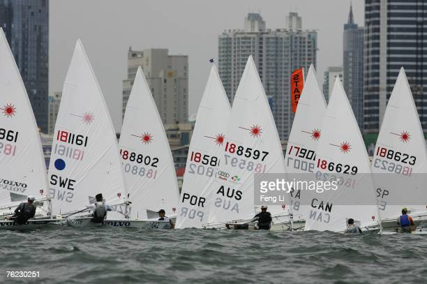 Sailors complete in the Laser Class during the Qingdao International Regatta on August 23, 2007 in Qingdao, China.The race is one of 26 test events...