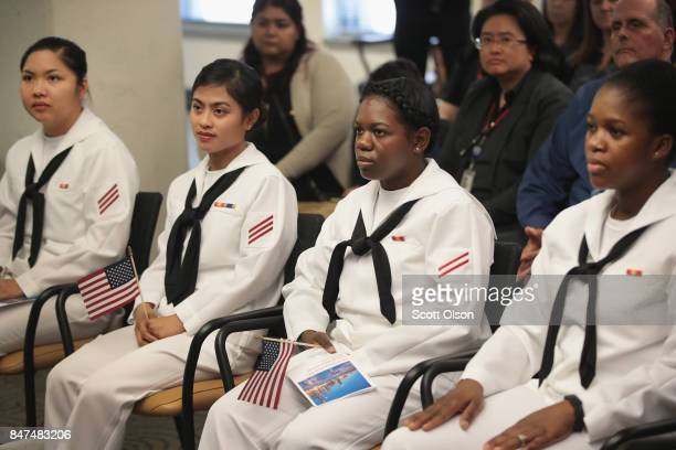 Sailors currently serving in the US Navy at Naval Station Great Lakes are sworn in as US Citizens during a ceremony on September 15 2017 in Chicago...