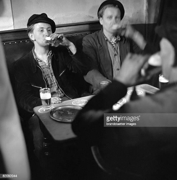Sailors drinking in a bar Hamburg Photograph 1955/56 [Matrosen in einem Lokal Hamburg Photographie 1955/56]