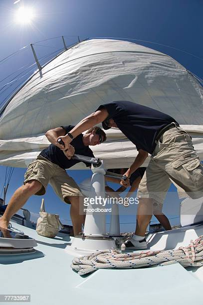Sailors During Yacht Race Raising Main Sail