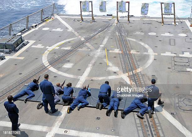 sailors fire m4a1 carbine assault rifles aboard uss halsey. - bang boat stock pictures, royalty-free photos & images
