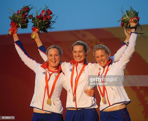 Sailors from Britain Pippa Wilson Sarah Webb and Sarah Ayton in the Ygling class celebrate their gold medals in the 2008 Beijing Olympic Games August...