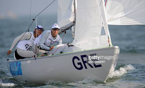 Sailors from Greece in the Yngling Class pull in their spinnaker after turning the mark in the Sailing competition of the 2008 Beijing Olympic Games...