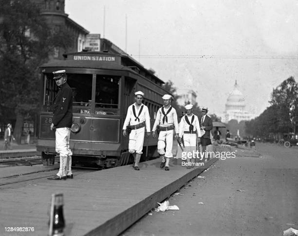 Sailors from the President's yacht Mayflower on guard duty at one of the street car intersections on Pennsylvania Avenue.