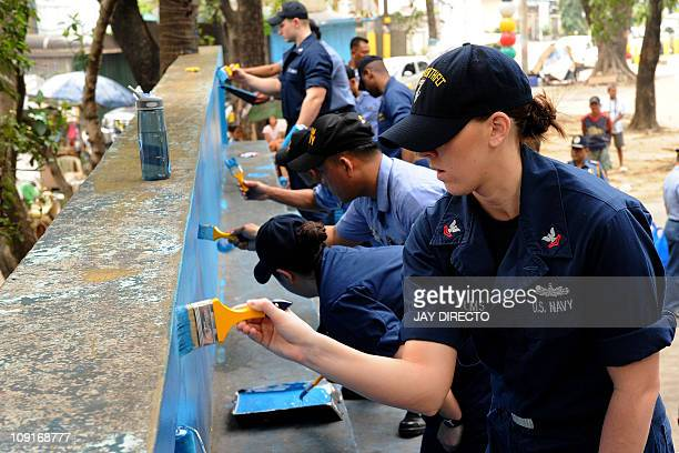 Sailors from the USS Blue Ridge and the Philippine navy paint a playground in Manila on February 16 2011 The USS Blue Ridge the mobile command center...