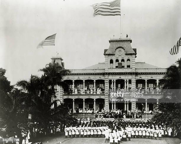 Sailors from the USS Boston form an honor guard in front of Iolani Palace during ceremonies annexing the Hawaiian Islands as a United States...