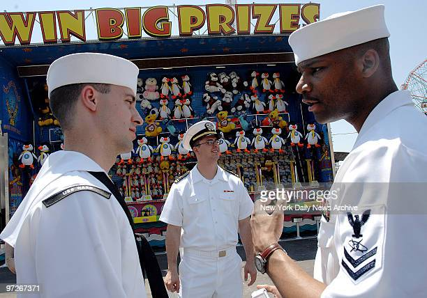 Sailors in Astroland in Coney Island LTJG Kevin Ross AT3 Brian Yancey MC2 Keith Darby