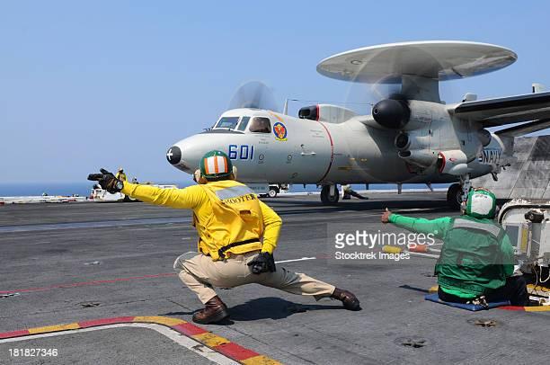 Sailors launch an E-2C Hawkeye aboard USS Dwight D. Eisenhower.