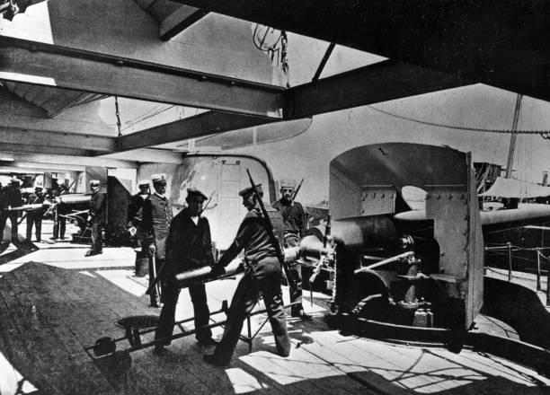Sailors loading a gun aboard a Spanish cruiser during...