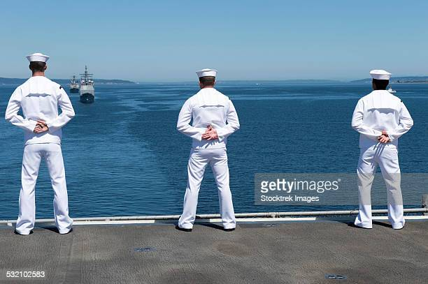 Sailors man the rails aboard USS Essex.
