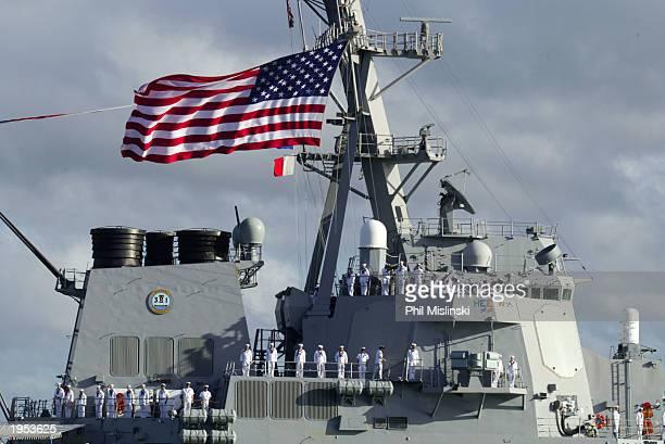 Sailors man the rails of the Aegis Destroyer USS Paul Hamilton as it enters Pearl Harbor April 26, 2003 in Honolulu, Hawaii. The Hamilton returned...