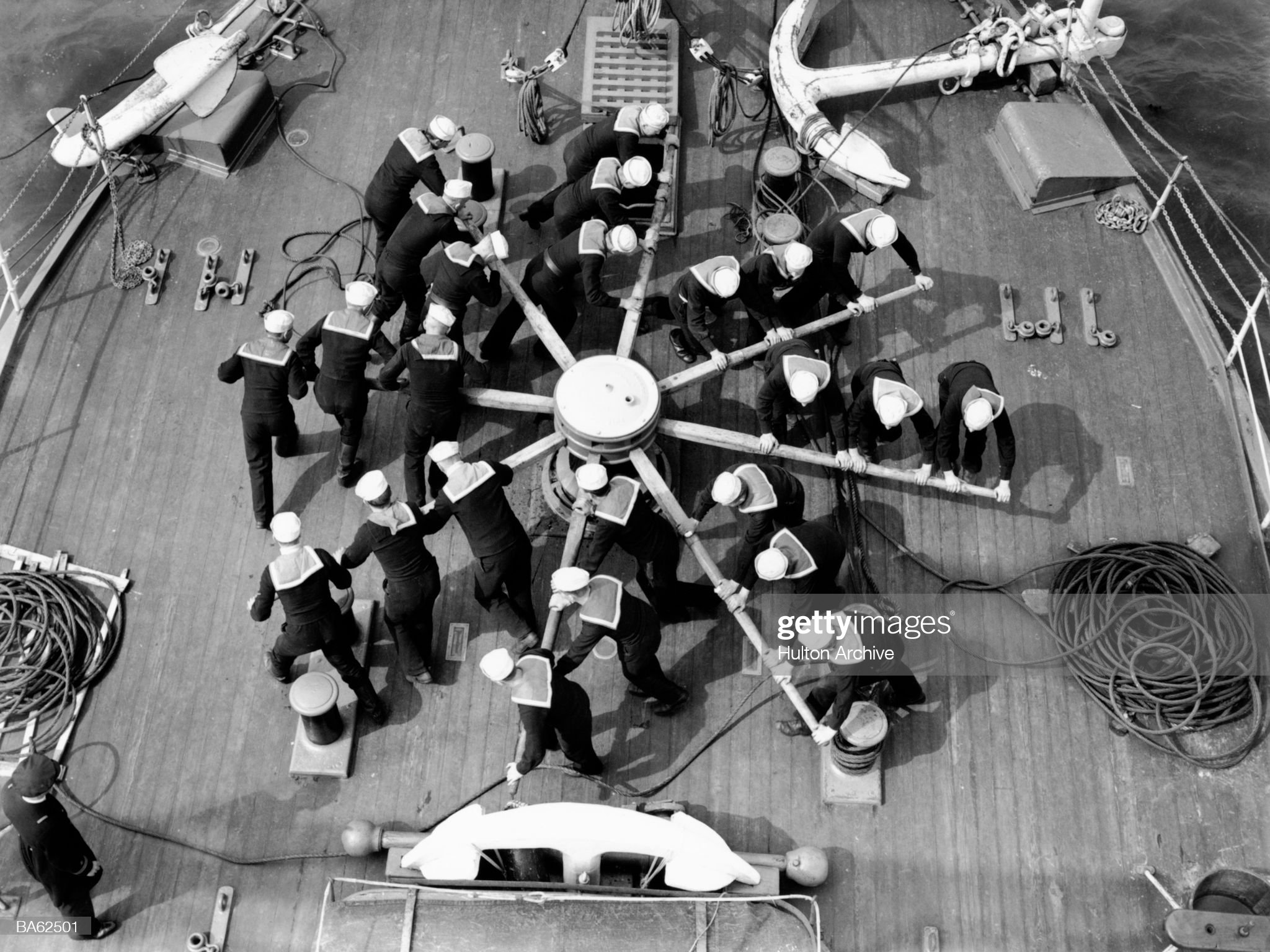 Sailors 'manning the capstan', elevated view (B&W) : News Photo