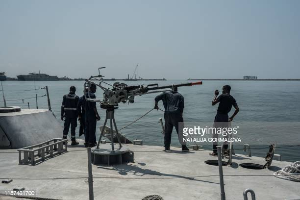 Sailors manoeuvre on a Ghana Navy vessel at Takoradi Naval Base on July 23, 2019. - Commemorating the 60th anniversary of the Ghanaian Navy, the...
