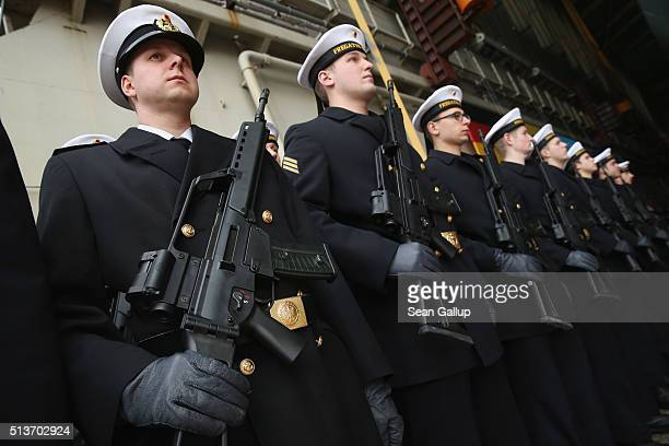 Sailors of the German Navy stand at attention while holding the Heckler and Koch G36 assualt rifle while attending the christening ceremony of the...