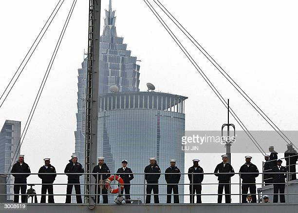Sailors of the USS Blue Ridge rank on the deck as it docks in the port of Shanghai, 24 February 2004. The command ship of the US Navy's Seventh Fleet...