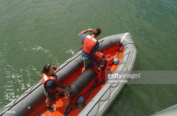 US sailors on a rubberboat after perimeter check along the coast of Cavite Philippines on 23 July 2002 The ship is part of the joint naval exercises...